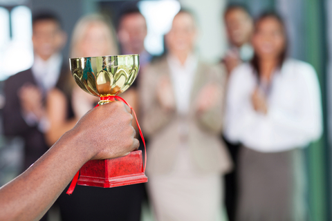 http://www.dreamstime.com/royalty-free-stock-images-team-winning-trophy-business-image32089159