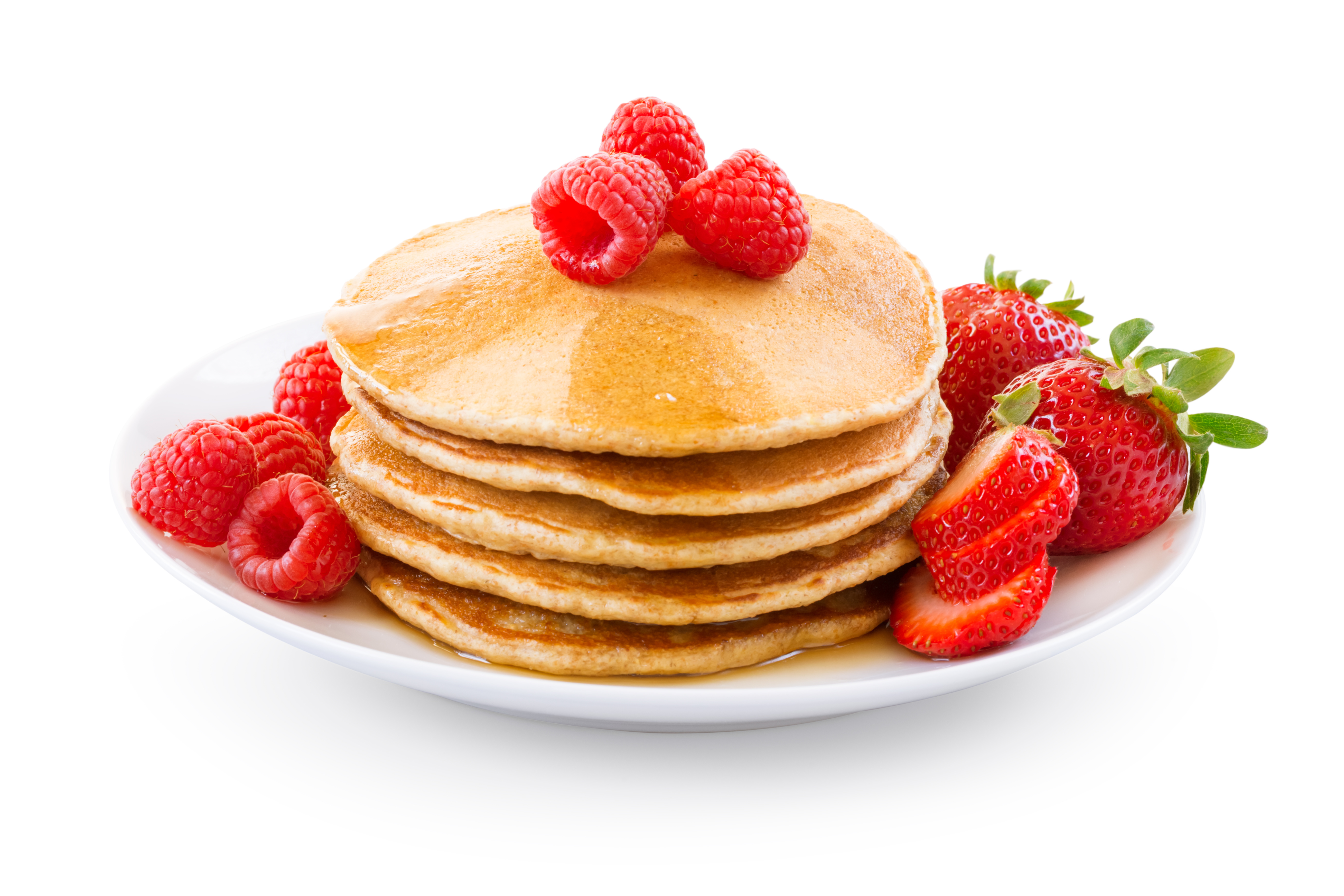 Pancakes with berries on a plate over white background.